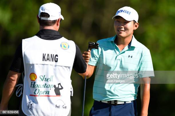 Sung Kang of South Korea celebrates after making a birdie putt on the second green during the second round of the Shell Houston Open at the Golf Club...