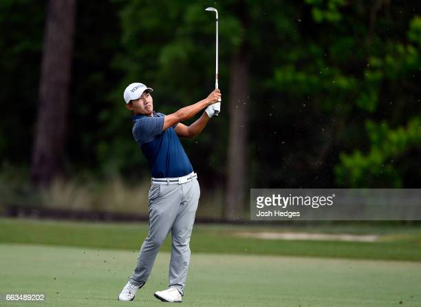 Sung Kang of South Korea plays his approach shot on the 13th hole during round three of the Shell Houston Open at the Golf Club of Houston on April 1...