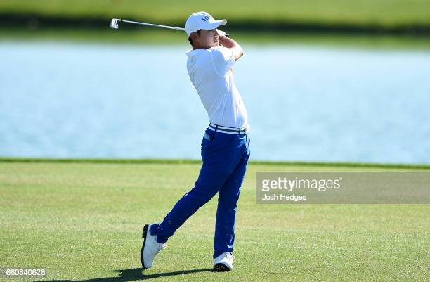 Sung Kang of South Korea plays his second shot from the fairway on the 18th hole during the first round of the Shell Houston Open at the Golf Club of...