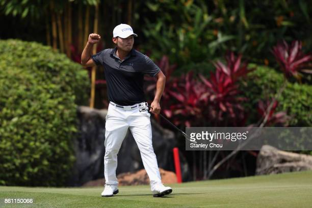 Sung Kang of South Korea reacts on the 17th hole during round three of the 2017 CIMB Classic at TPC Kuala Lumpur on October 14 2017 in Kuala Lumpur...