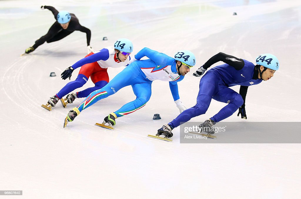 Sung Si-Bak of South Korea leads <a gi-track='captionPersonalityLinkClicked' href=/galleries/search?phrase=Nicola+Rodigari&family=editorial&specificpeople=768364 ng-click='$event.stopPropagation()'>Nicola Rodigari</a> of Italy, <a gi-track='captionPersonalityLinkClicked' href=/galleries/search?phrase=Maxime+Chataignier&family=editorial&specificpeople=504686 ng-click='$event.stopPropagation()'>Maxime Chataignier</a> of France and Blake Skjellerup of New Zealand in the Short Track Speed Skating Men's 1,000 m on day 6 of the Vancouver 2010 Winter Olympics at Pacific Coliseum on February 17, 2010 in Vancouver, Canada.