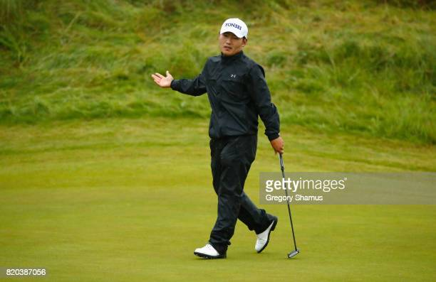 SungHoon Kang of Korea reacts to a putt on the 12th green during the second round of the 146th Open Championship at Royal Birkdale on July 21 2017 in...