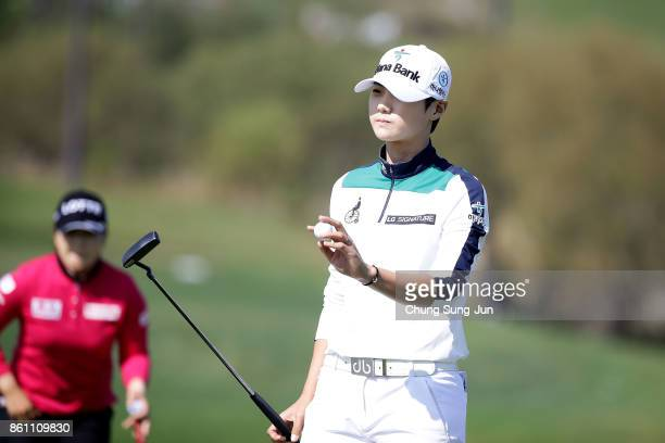 SungHyun Park of South Korea reacts after a putt on the 9th green during the third round of the LPGA KEB Hana Bank Championship at the Sky 72 Golf...