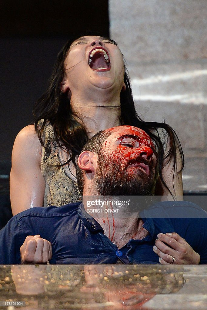 Sung-Im Her and Julien Faure perform a play written and directed Belgian Jan Lauwers 'Place du marché 76' on July 7, 2013 in Avignon, during the 67th International Theatre festival. AFP PHOTO / BORIS HORVAT