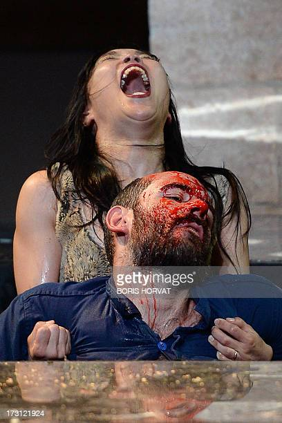 SungIm Her and Julien Faure perform a play written and directed Belgian Jan Lauwers 'Place du marché 76' on July 7 2013 in Avignon during the 67th...