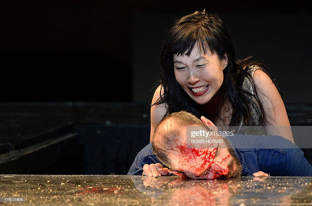 Sung-Im Her and Julien Faure perform a play written and directed Belgian Jan Lauwers 'Place du marché 76' on July 7, 2013 in Avignon, during the 67th International Theatre festival.