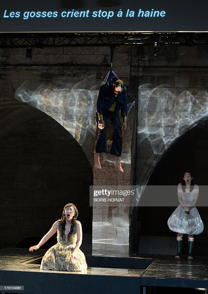 Sung-Im Her, Julien Faure and Yumiko Funaya perform a play written and directed Belgian Jan Lauwers 'Place du marché 76' on July 7, 2013 in Avignon, during the 67th International Theatre festival. AFP PHOTO / BORIS HORVAT