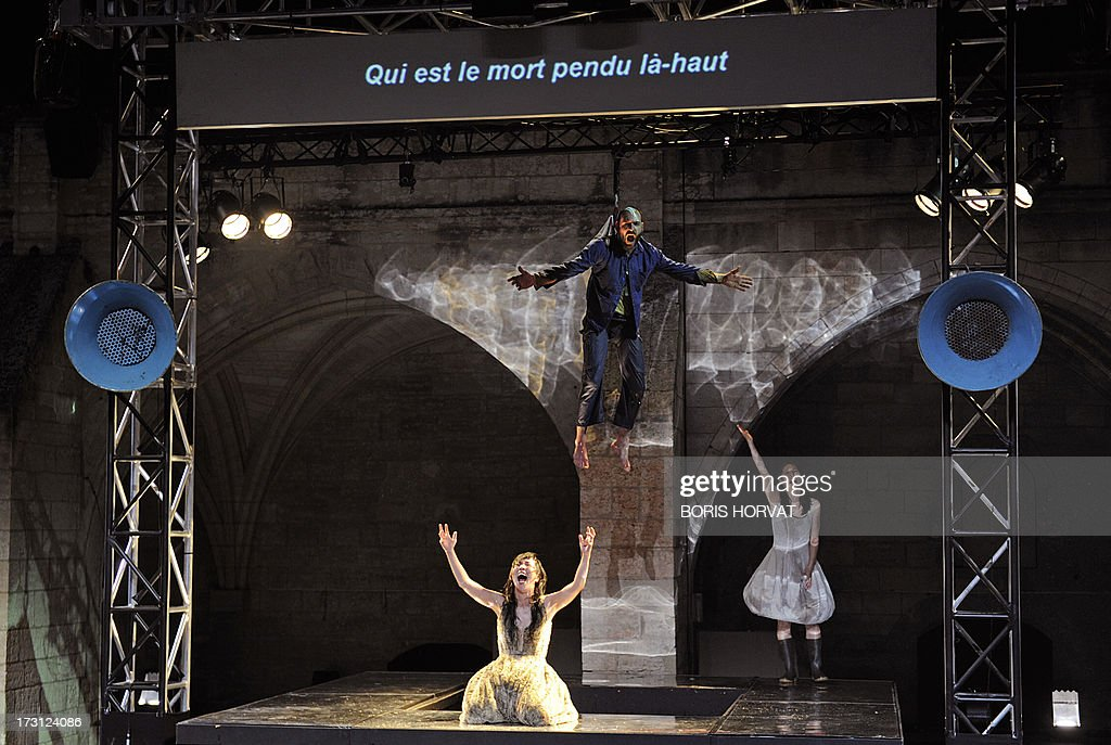 Sung-Im Her, Julien Faure and Yumiko Funaya perform a play written and directed Belgian Jan Lauwers 'Place du marché 76' on July 7, 2013 in Avignon, during the 67th International Theatre festival.