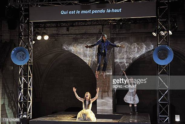 SungIm Her Julien Faure and Yumiko Funaya perform a play written and directed Belgian Jan Lauwers 'Place du marché 76' on July 7 2013 in Avignon...