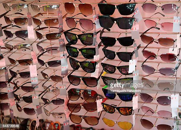 Sunglasses are displayed in a shop at Ameyoko market in Tokyo Japan Sep 2013 Ameyoko is a bustling outdoor marketplace and Tokyo's most busiest...