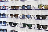 Sunglasses for sale, placed on the shelves, horizontal formation