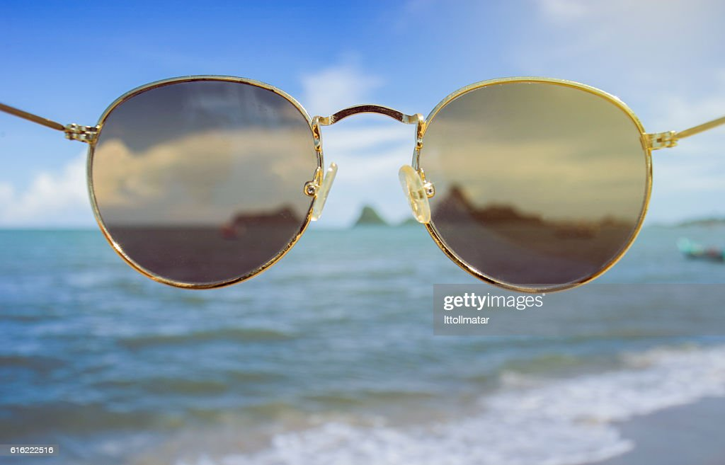 sunglasses front of the camera : Stock Photo