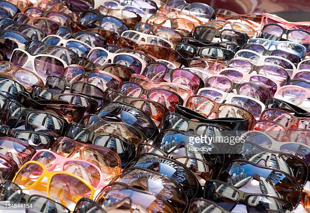 Sunglasses, lots of