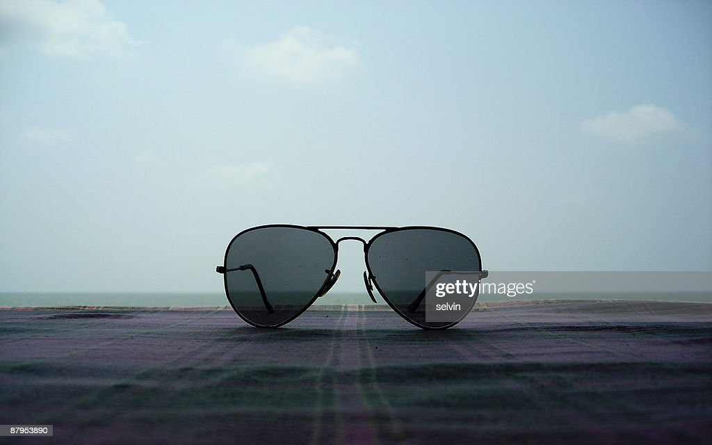 Sunglasses on a beachside resort : Stock Photo