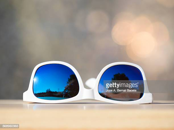 Sunglasses on a table outdoors
