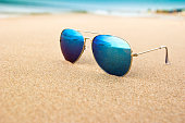 sea reflecting in the sunglasses on the beach