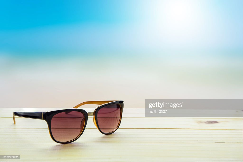 Sunglasses on the table : Stock Photo