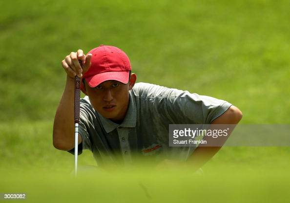SungMan Lee of Korea lines up his putt on the fifth green during the final round at The Carlsberg Malaysian Open Golf at Saujana Golf and Country...