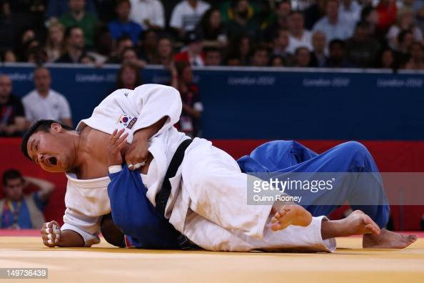 SungMin Kim of Korea and Tomohiko Hoshina of Philippines compete in the Men's 100 kg Judo on Day 7 of the London 2012 Olympic Games at ExCeL on...