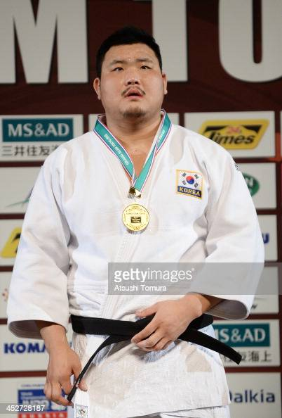 SungMin Kim of Korea stands on the podium at the men's 100kg medal ceremony during day three of the Judo Grand Slam at the on December 1 2013 in...