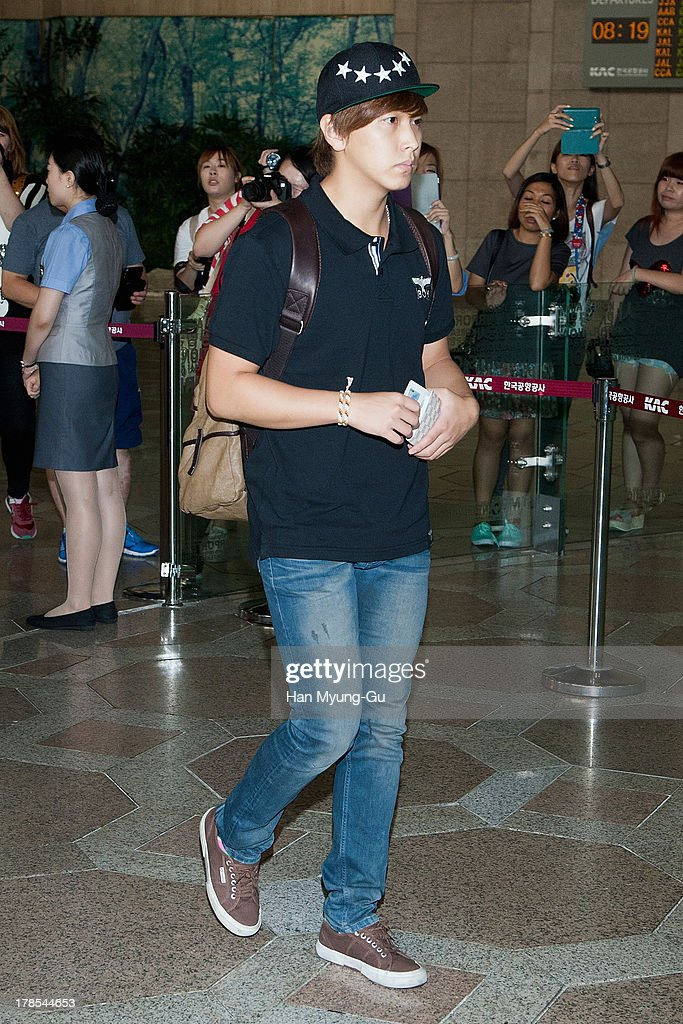 Sungmin of South Korean boy band Super Junior is seen on departure at Gimpo International Airport on August 30, 2013 in Seoul, South Korea.