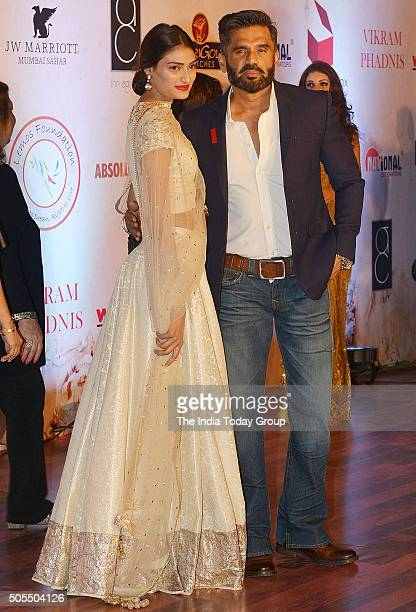 Suniel Shetty and Athiya Shetty at Vikram Phadniss 25th anniversary fashion show in Mumbai