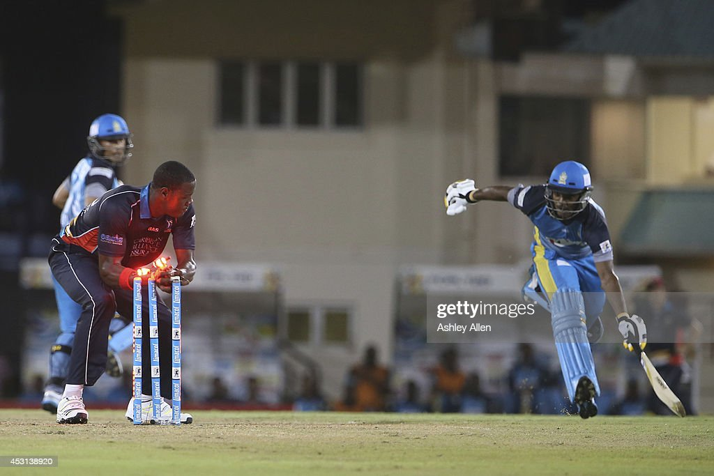 Sunil Ambris (R) of the St Lucia Zouks is run out by Antigua Hawksbills Carlos Brathwait (L) during a match between St. Lucia Zouks and Antigua Hawksbills as part of week 4 of the Limacol Caribbean Premier League 2014 at Beausejour Stadium on August 03, 2014 in Castries, St. Lucia.