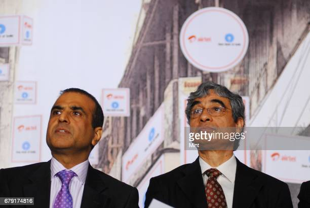 Sunil Bharti Mittal Chairman and Managing Director of Bharti Group photographed along with O P Bhatt Chairman of SBI during the signing of a JV...