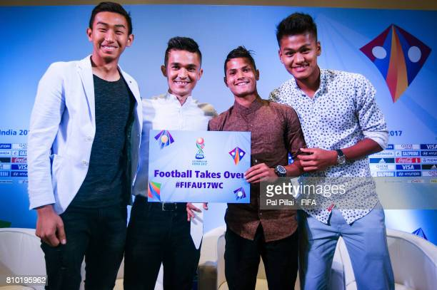 Sunil Chhetri Indian Football Captain poses for a photograph with the U17 players Dheeraj Singh Sanjeev Stalin and Jackson Singh as they get ready...
