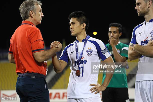 Sunil Chhetri is consoled by Albert Roca the head coach / manager of Bengaluru FC of India at the end of the AFC Cup Final match between JSW...