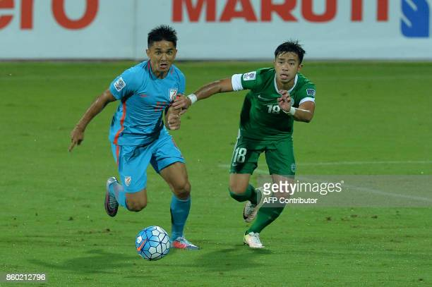 Sunil Chhetri of India and Lei Ka Hou of Macau chase the ball during the 2019 AFCAsian Cup qualifying match between India and Macau held at the...