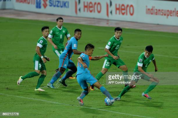 Sunil Chhetri of India and tackles the ball with a bunch of Macau players during the 2019 AFCAsian Cup qualifying match between India and Macau held...