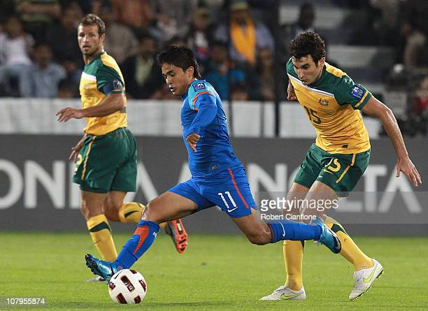 Sunil Chhetri of India gets the ball away from Mile Jedinak of Australia during the AFC Asian Cup Group C match between India and Australia at AlSadd...