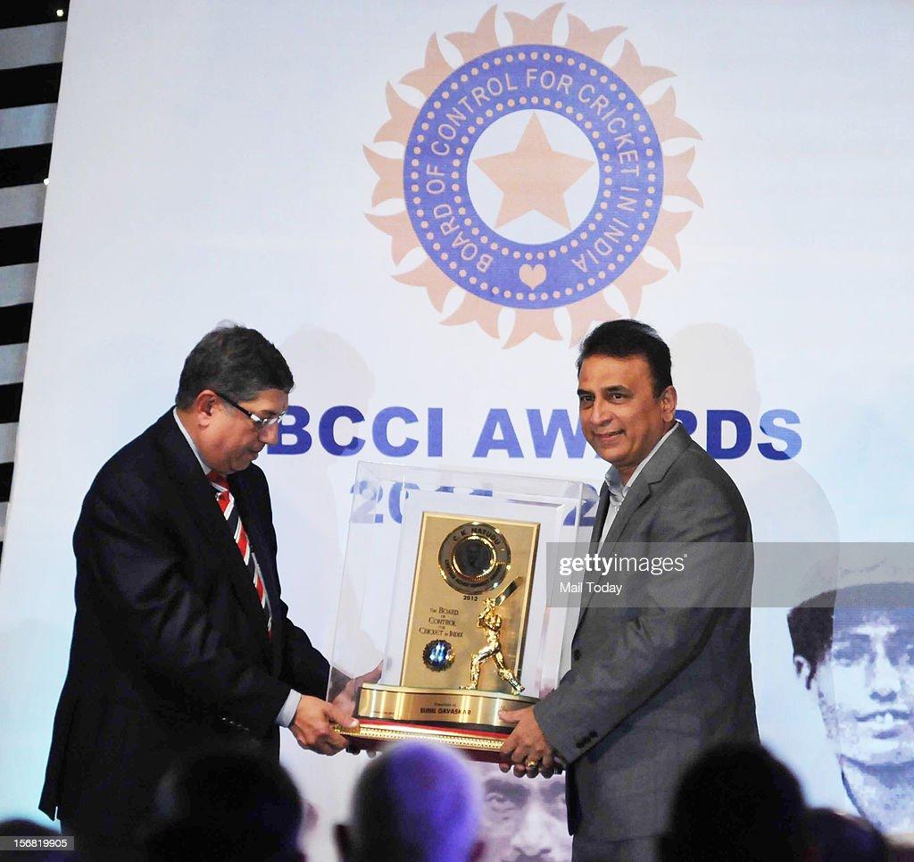 Sunil Gavaskar receives the CK Naydu lifetime achievement Award from the BCCI president N Srinivasan during the annual BCCI 2011-2012 awards ceremony in Mumbai on Wednesday.