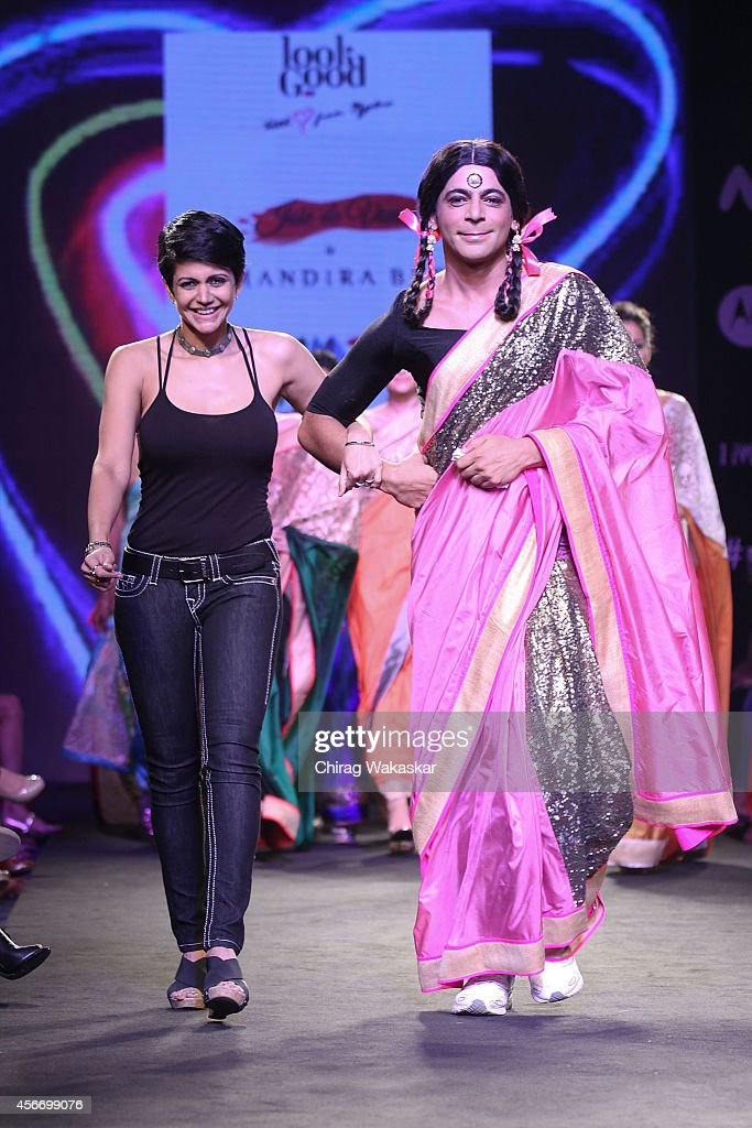 Sunil Grover (R) & <a gi-track='captionPersonalityLinkClicked' href=/galleries/search?phrase=Mandira+Bedi&family=editorial&specificpeople=703799 ng-click='$event.stopPropagation()'>Mandira Bedi</a> (L) walk the runway during day 3 of Myntra Fashion Weekend 2014 at The Palladium Hotel on October 5, 2014 in Mumbai, India