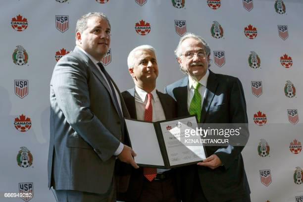 Sunil Gulati President of United States Soccer Federation poses for a picture next to Victor Montagliani CONCACAF President and Decio de Maria...