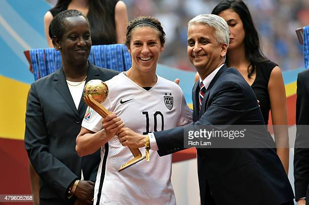 Sunil Gulati the president of the United States Soccer Federation poses for a picture with Carli Lloyd of the United States after winning the Golden...