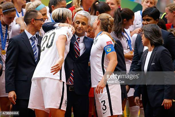 Sunil Gulati the president of the United States Soccer Federation hugs both Abby Wambach and Christie Rampone of the United States as they celebrate...