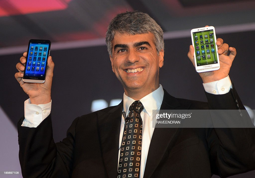 Sunil Lalvani, BlackBerry Managing Director for India, displays the BlackBerry Z30 smartphone during a product launch in New Delhi on October 24, 2013.