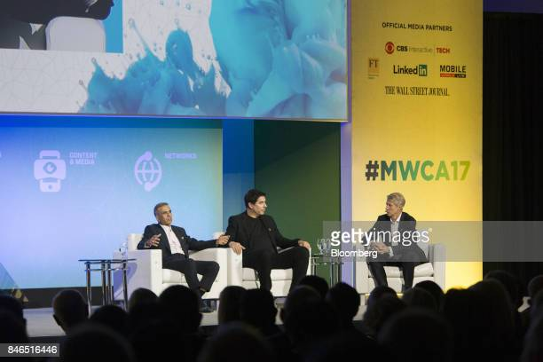 Sunil Mittal chairman of Bharti Airtel Ltd left speaks as Marcelo Claure chief executive officer of Sprint Corp center and Mats Granryd director...