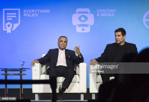 Sunil Mittal chairman of Bharti Airtel Ltd left speaks as Marcelo Claure chief executive officer of Sprint Corp listens during the Mobile World...