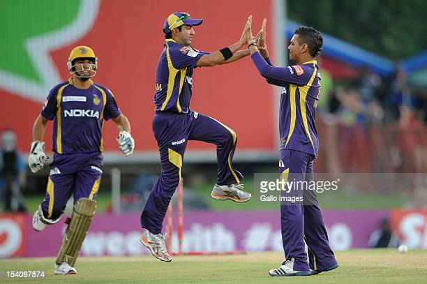 Sunil Narine of the Knight Riders celebrates with Gautam Gambhir after capturing the wicket of Mahela Jayawardene of the Daredevils during the...