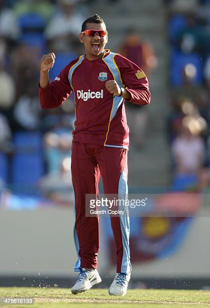Sunil Narine of the West Indies celebrates dismissing Joe Root of England during the 1st One Day International between West Indies and England at Sir...