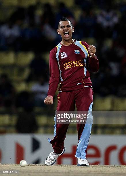 Sunil Narine of West Indies celebrates the wicket of Martin Guptill during the Super Eights Group 1 match between New Zealand and West Indies at...