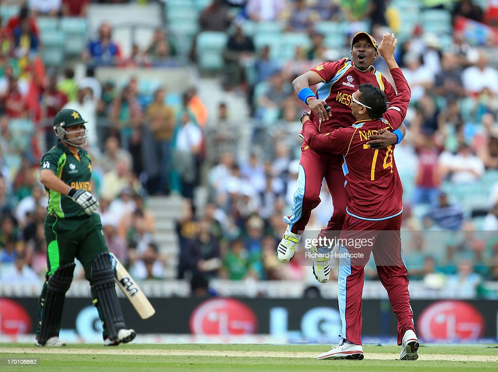 <a gi-track='captionPersonalityLinkClicked' href=/galleries/search?phrase=Sunil+Narine&family=editorial&specificpeople=8287526 ng-click='$event.stopPropagation()'>Sunil Narine</a> of West Indies is congratulated by Dwyane Bravo as he takes with wicket of <a gi-track='captionPersonalityLinkClicked' href=/galleries/search?phrase=Kamran+Akmal&family=editorial&specificpeople=221679 ng-click='$event.stopPropagation()'>Kamran Akmal</a> of Pakistan during the ICC Champions Trophy group B match between West Indies and Pakistan at The Oval on June 7, 2013 in London, England.