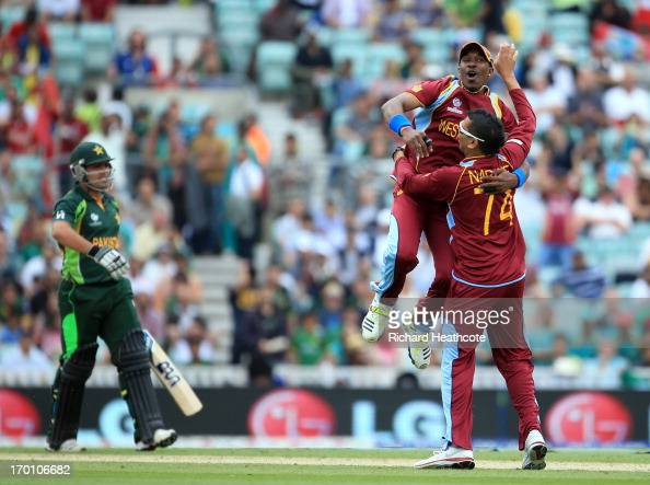 Sunil Narine of West Indies is congratulated by Dwyane Bravo as he takes with wicket of Kamran Akmal of Pakistan during the ICC Champions Trophy...