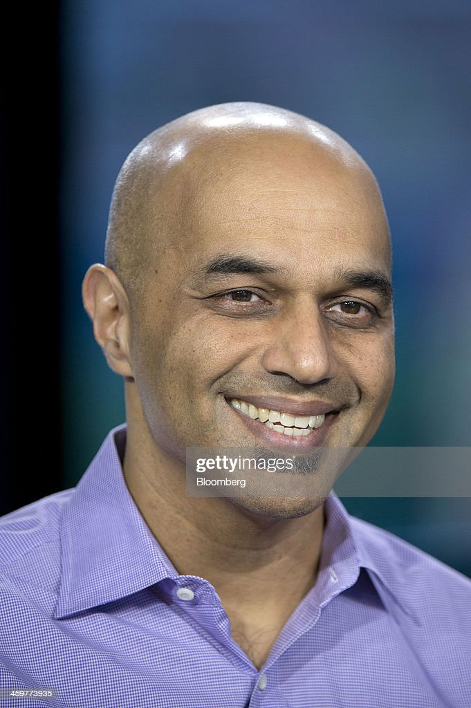 Sunil Paul, chief executive officer of SideCar Technologies Inc., smiles during a Bloomberg West Television interview in San Francisco, California, U.S., on Thursday, Dec. 26, 2013. SideCar offers taxi services similar to that of Uber Technology Inc. and Lyft Inc. Photographer: David Paul Morris/Bloomberg via Getty Images