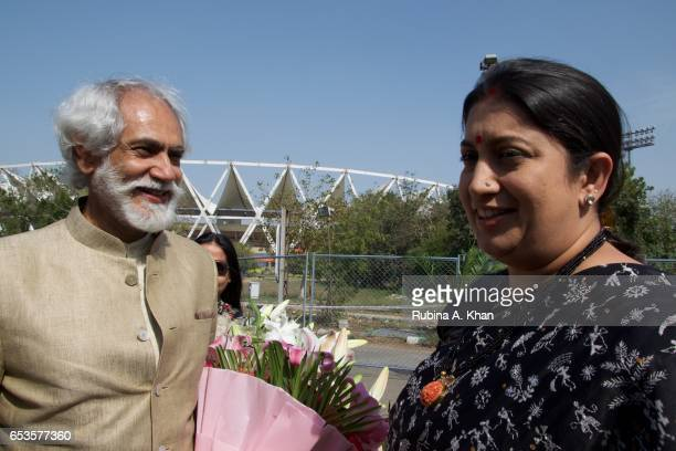 Sunil Sethi President of the Fashion Design Council of India with Smriti Irani Union Minister of Textiles Government of India on opening day of India...