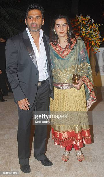 Sunil Shetty with his wife Mana Shetty at Imran Khan and Avantika Malik's wedding reception party which was organised by Aamir Khan and Kiran Rao at...