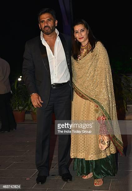 Sunil Shetty with his wife Mana Shetty at Rahul Thackeray and DrAditi's wedding reception in Mumbai